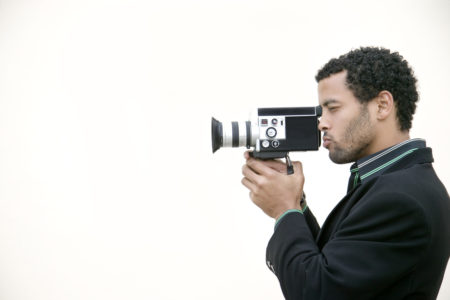 Man Filming --- Image by © Royalty-Free/Corbis